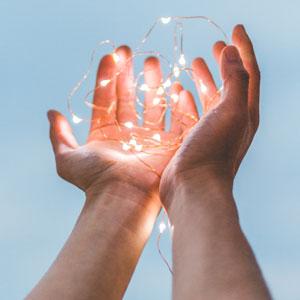 Mans amb llums